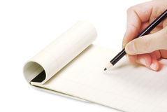 Pencil in hand writing Stock Image