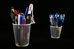 Pencil holder. Office supplies isolated on black background Stock Photography