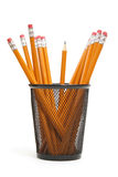 Pencil Holder. A single sharpened pencil standing upright in amoungst many other unsharpened pencils Stock Image