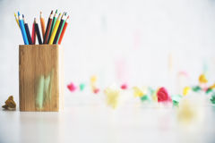 Pencil holder on messy desk Royalty Free Stock Images
