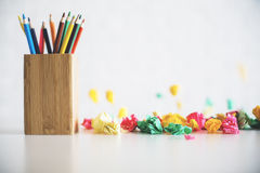 Pencil holder on messy table Royalty Free Stock Photography