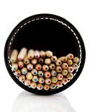 Pencil holder with wooden pencils lying on the desk Stock Photography
