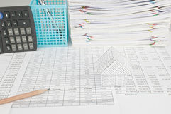 Pencil and house on finance account with blue basket Stock Photos