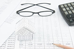 Pencil and house on finance account with spectacles and calculator Royalty Free Stock Photo