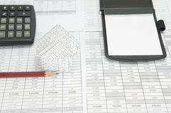 Pencil and house have blur calculator and notepad as background Stock Photos