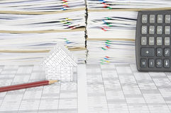 Pencil with house have overload paperwork with envelope as background Stock Photos
