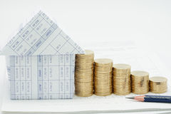 Pencil and house with many pile of gold coins. On finance account stock images