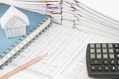 Pencil and house on notebook with calculator Stock Photos