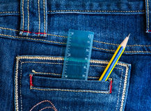 Pencil with jean. Pencil and ruler in blue jean pocket Stock Photo