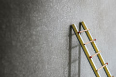 Pencil ladder leaning against grunge wall with copy space. succe Stock Image