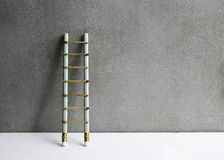Pencil ladder leaning against grunge wall with copy space. succe Stock Photo