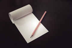 Pencil laying on blank note paper, Creative work, writing, drawing concept Stock Image