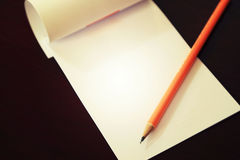 Pencil laying on blank note paper, Creative work, writing, drawing concept Royalty Free Stock Photo