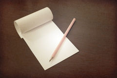 Pencil laying on blank note paper, Creative work, writing, drawing concept Royalty Free Stock Image