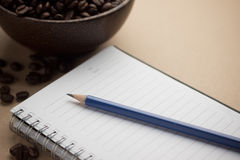 Pencil Laying On A Notebook Stock Image