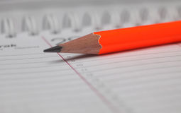 Pencil laying on notebook Stock Photography