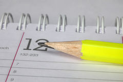 Pencil laying on notebook Royalty Free Stock Photography