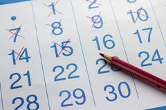 The pencil lies on the calendar royalty free stock images