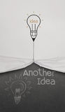Pencil lightbulb draw rope open wrinkled paper show another idea Stock Images