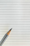 Pencil on lined paper Royalty Free Stock Images