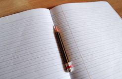 Pencil lying on a blank paper Stock Images