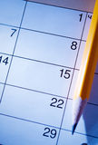 Pencil lying on a calendar Stock Image