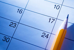 Pencil lying on a calendar Royalty Free Stock Photo