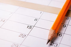 Pencil lying on a calendar Royalty Free Stock Image