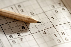Pencil lying on a sudoku grid Royalty Free Stock Images