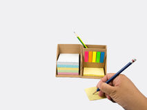 Pencil in man hand and paper set. The pencil in man hand and posit note paper set Royalty Free Stock Image