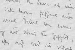 Pencil Manuscript from the Nineteen-Twenties - Detail. Detail of an individual handwriting style from the 1920s - written with a soft pencil on linen paper royalty free stock photo