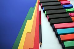 Pencil and markers. With multi-colored files Stock Photos