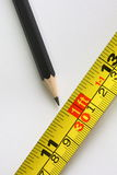 Pencil and measure stock photo