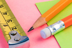 Pencil, measuring tape and paper note. Simple pencil, measuring and paper note. Royalty Free Stock Image