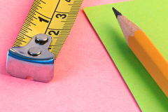 Pencil, measuring tape and paper note. Simple pencil, measuring and paper note. Stock Photography