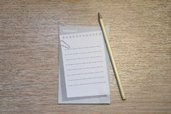 Pencil and memo pad concept Stock Image