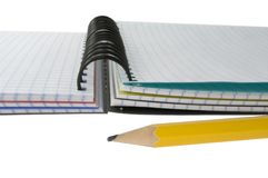 Pencil and note-book. Stock Images