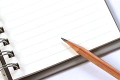 A pencil on note book Royalty Free Stock Image