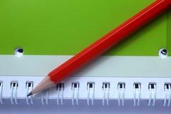 Pencil on note book Stock Photos