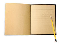 Pencil and note book. Yellow pencil and note book isolated on white background Stock Photography