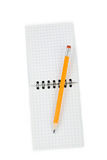 Pencil and note pad Stock Images