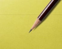 Pencil on a note. Pictured a pencil on a note paper royalty free stock photography