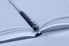Pencil and notebook. Pencil and open organizer - toned closeup image Stock Photography