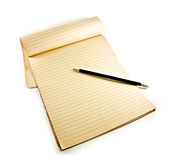 Pencil on notebook. Pencil with notebook on white stock photography