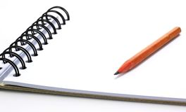 Pencil on the notebook. Isolated on white Royalty Free Stock Photography