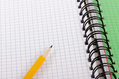 Pencil and notebook. Royalty Free Stock Image