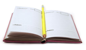 Pencil and notebook. Yellow pencil and pink notebook Royalty Free Stock Images
