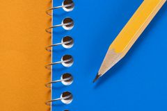 Pencil and notebook. Stock Image