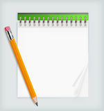 Pencil & notebook Stock Image