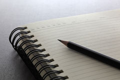 Pencil on notebook. Closeup image Royalty Free Stock Photo